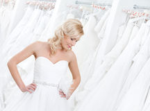 Trying on an amasing wedding gown Royalty Free Stock Photos