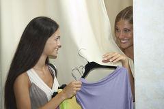 Trying dress on Stock Image