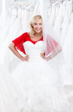 Trying a fascinating wedding gown on Royalty Free Stock Photography