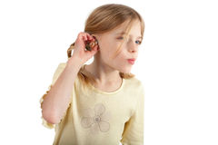 Trying a hearing aid royalty free stock image