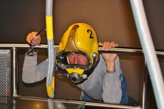 Trying on a helmet for oil workers. Stavanger, Norway. Stock Photography