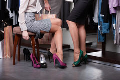 Trying on high-heeled shoes Royalty Free Stock Images