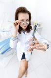 Trying on medical spectacles and syringe Stock Images