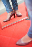 Trying on pair shoes in shop Royalty Free Stock Image