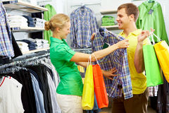 Trying shirt on royalty free stock photo