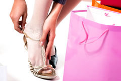 Trying on shoes. Woman's foot trying on shoe Royalty Free Stock Photos