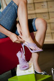 Trying shoes on Stock Images