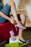 Trying shoes on Royalty Free Stock Images