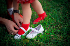 Trying on shoes. Mother helps to try on new shoes Royalty Free Stock Image