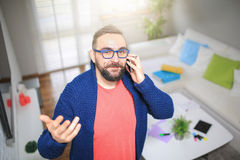 Trying to explain something over the phone Stock Photos