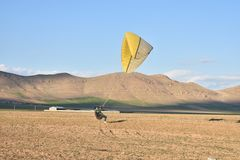 Trying to fly with paragliders stock images