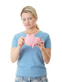 Trying To Get Money From Piggy Bank Stock Photography