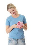 Trying to get money from piggy bank Royalty Free Stock Image