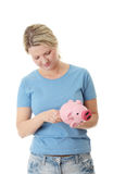 Trying to get money from piggy bank Stock Image