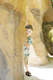 Trying to Hide. A playful boy trying to hide behind the rocks Royalty Free Stock Photography