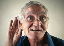 Trying to listen. Elderly man trying to listen Royalty Free Stock Photos