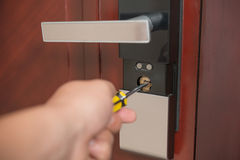Trying to open a door lock Royalty Free Stock Photography