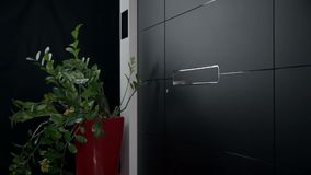 Trying to open the door. Opening, closing and sliding on various elegant modern doors stock video