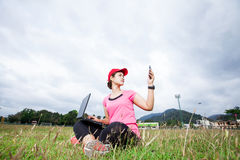 Trying to pick up the signal on her mobile phone Royalty Free Stock Images