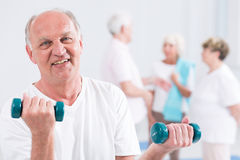 Trying to remain in good shape in his elderly days Royalty Free Stock Photo