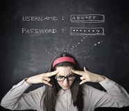 Trying to remember. Woman trying to remember a password Royalty Free Stock Photo