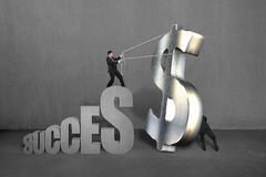 Trying to stand large money symbol for success Stock Images