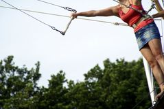 Trying trapeze. A lady in a miniskirt trying out trapeze Stock Image