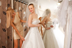 Trying On A Wedding Dress Royalty Free Stock Photo