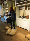 Trying on wooden shoes - will they fit me? royalty free stock photography