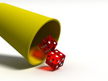 Trying your luck 2. Two dice falling out of a dice cup Stock Photo