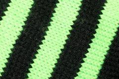 Trykotowa czarna i zielona tkanina Zdjęcia Stock
