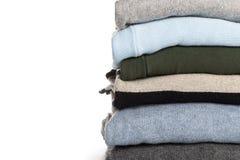 Trykotowi pulowery na białym tle fotografia royalty free