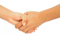 Trząść ręki chłopiec i potomstwa Fotografia Stock