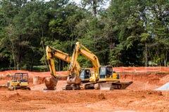 Trzy Żółtej budowy maszyny Obrazy Royalty Free