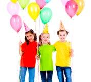 Trzy ślicznej małej dziewczynki z coloured balonami Zdjęcia Stock