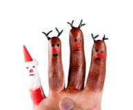 Trzy śmieszny renifer i Santa malowaliśmy na palcach Obrazy Royalty Free