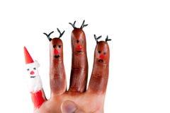 Trzy śmieszny renifer i Santa malowaliśmy na palcach Zdjęcie Stock