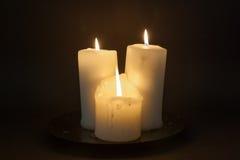 Trzy świeczki z światłami Zdjęcia Royalty Free