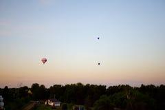 Trzy balonu w tle zmierzchu niebo Obraz Stock