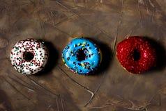 Trzy barwionego donuts obraz stock