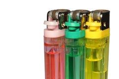 Trzy barwionej zapalniczki zdjęcie stock