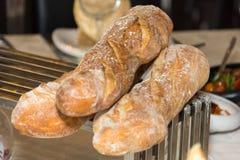 Trzy bochenka chleb na stole Zdjęcia Royalty Free