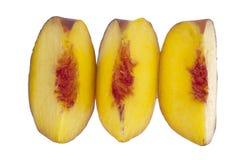 Trzy brzoskwinia plasterka z rzędu Obraz Royalty Free