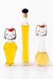 Trzy butelki oliwa z oliwek Zdjęcia Stock