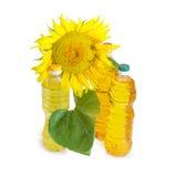 Trzy butelki różny słonecznikowy olej i kwiat słonecznik Zdjęcia Royalty Free