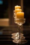 Trzy candlestick na łomotać stół przy nocą Fotografia Royalty Free