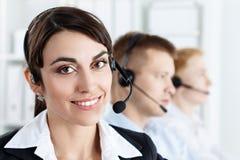 Trzy centrum telefoniczne usługowego operatora przy pracą obrazy stock