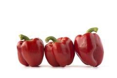 Trzy czerwonego słodkiego pieprzu na białym tle Obraz Royalty Free