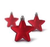 Trzy czerwonej Bożenarodzeniowej dekoraci gwiazdy Zdjęcie Royalty Free