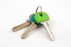 Trzy Domowego klucza z coloured nakrętkami Obraz Stock